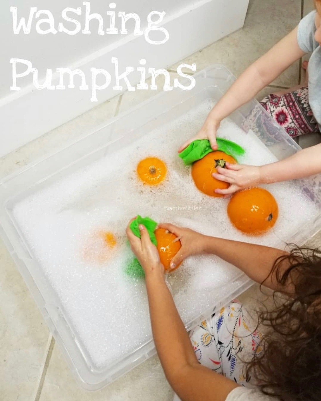 washing pumpkins for preschoolers and toddlers